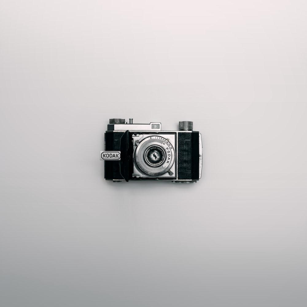 silver and black Kodak DSLR camera