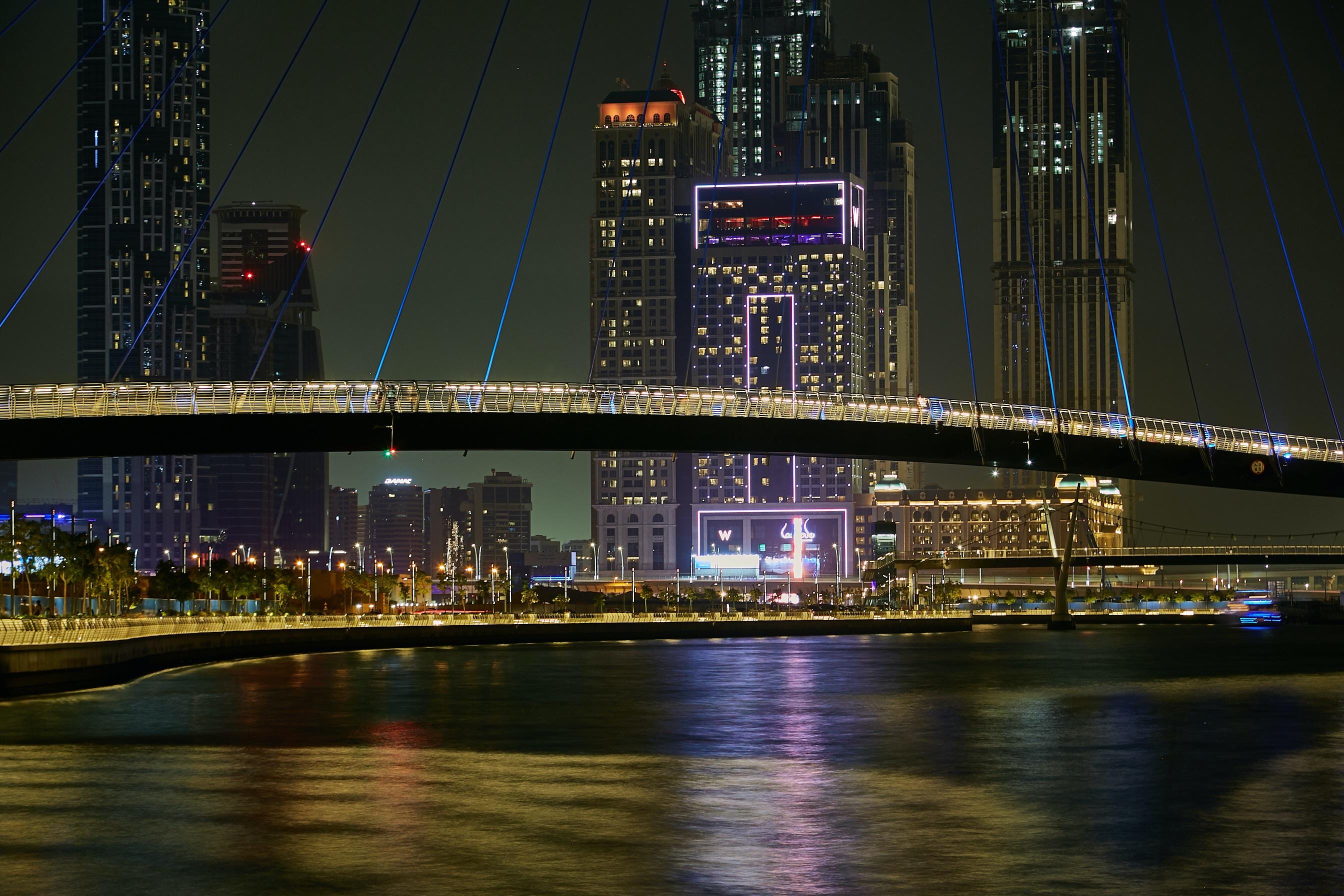 black suspension bridge during night time
