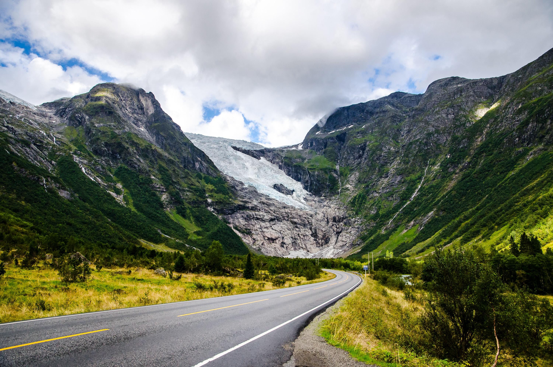 photo of concrete pavement heading mountain