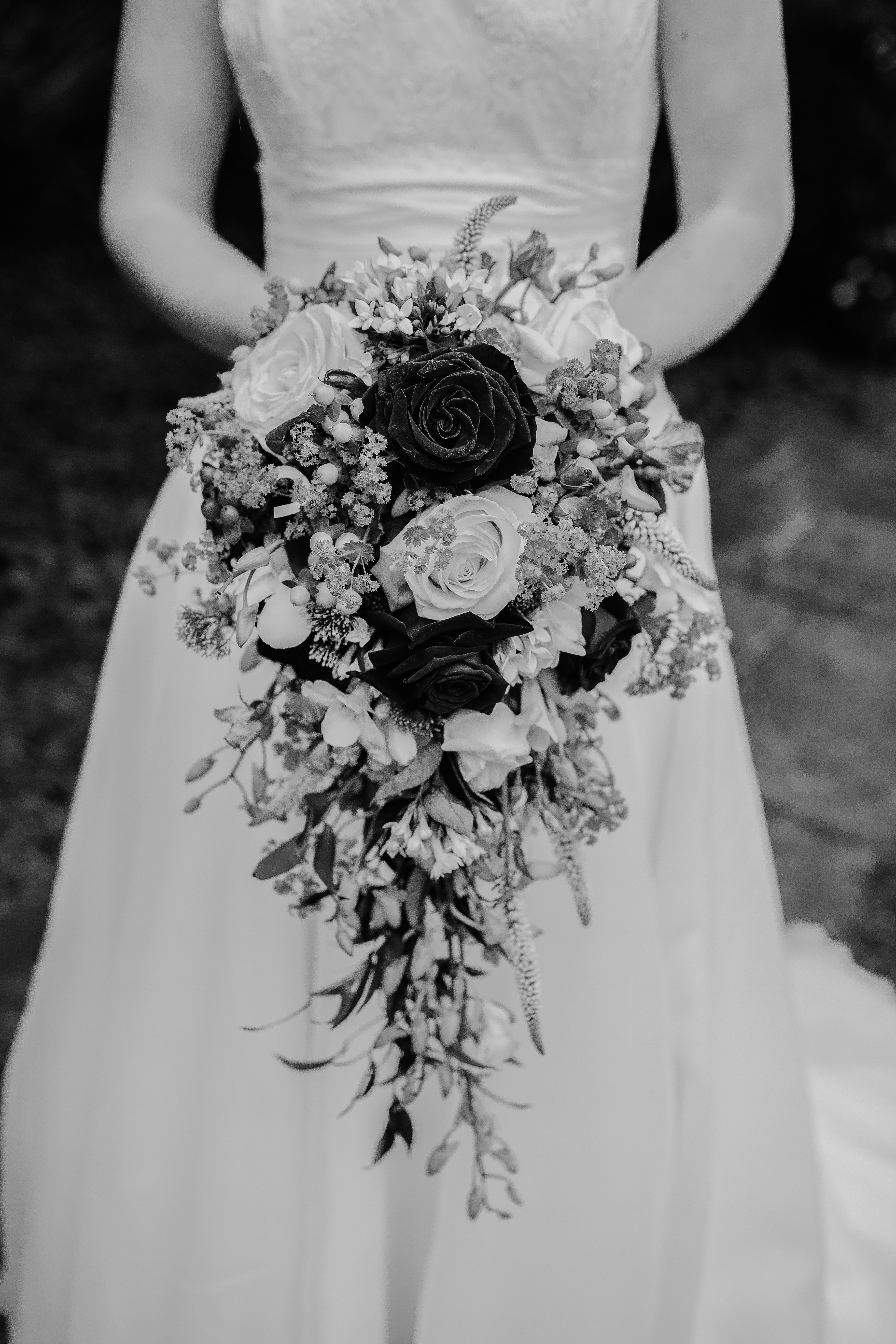 grayscale photography of woman in wedding gown