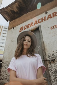 woman wearing pink t-shirt and cap