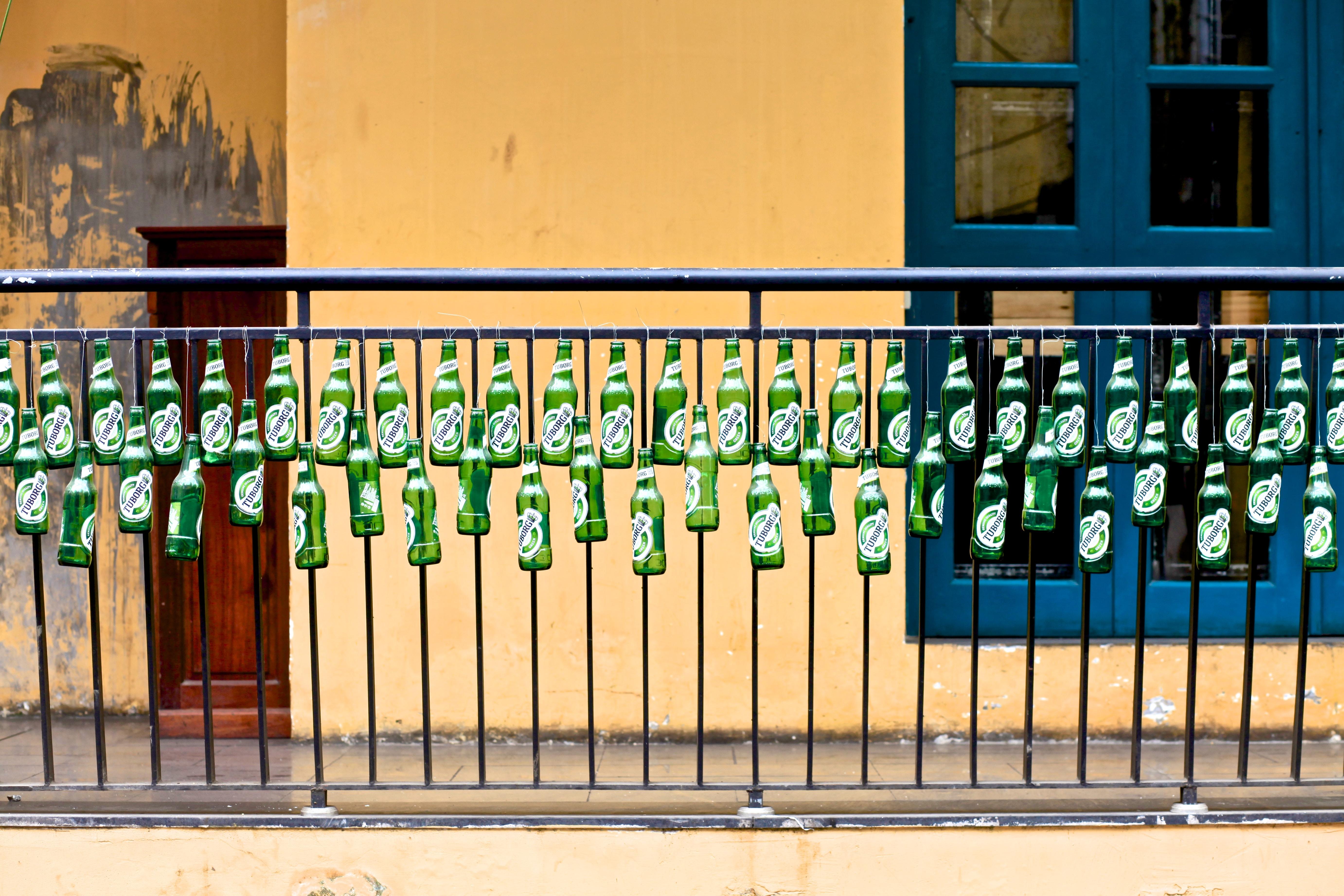 bottles hanged on hand rails