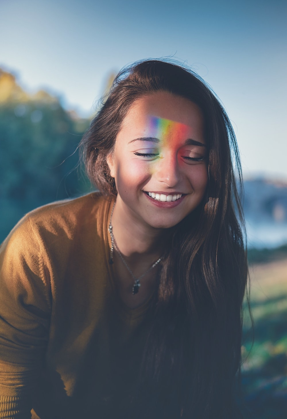 shallow focus photography of smiling woman