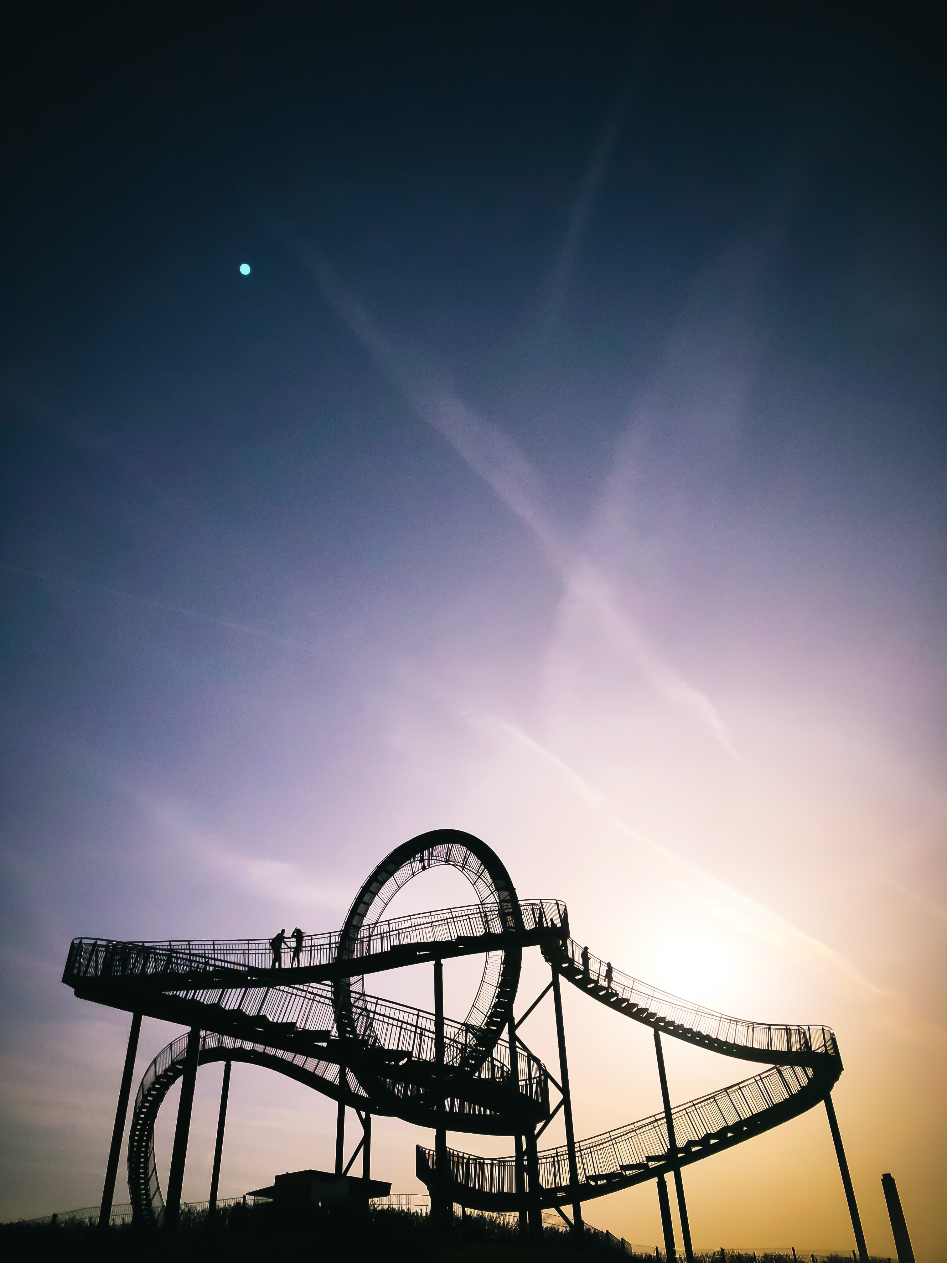 two person on top of roller coaster