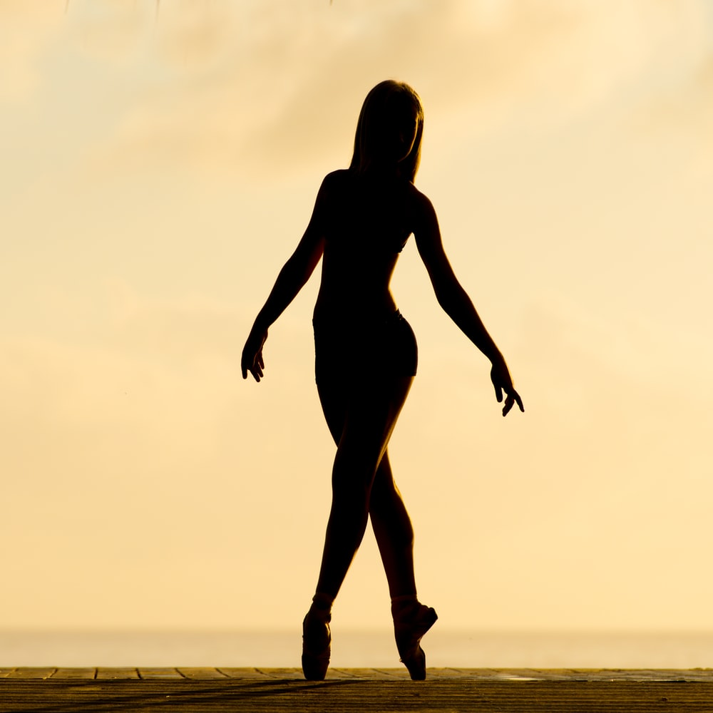 silhouette of woman performing ballet