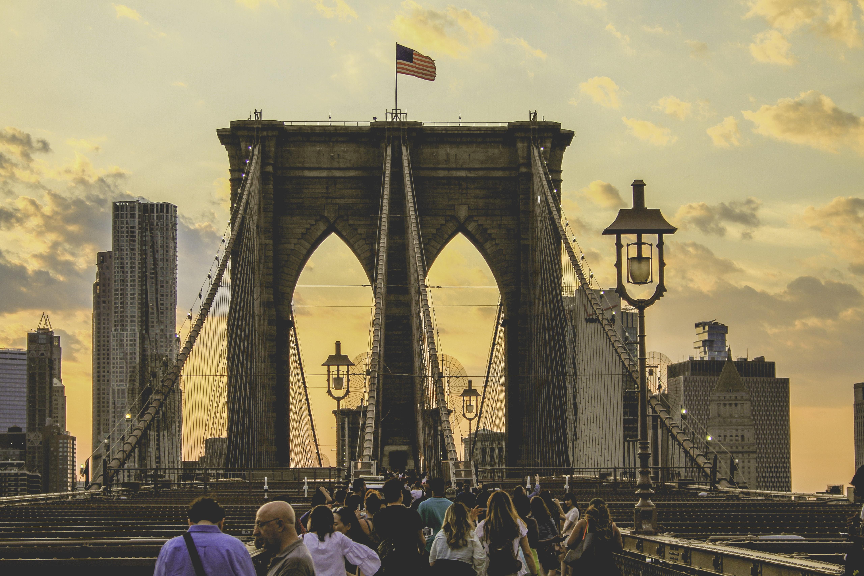 people walking on Brooklyn Bridge