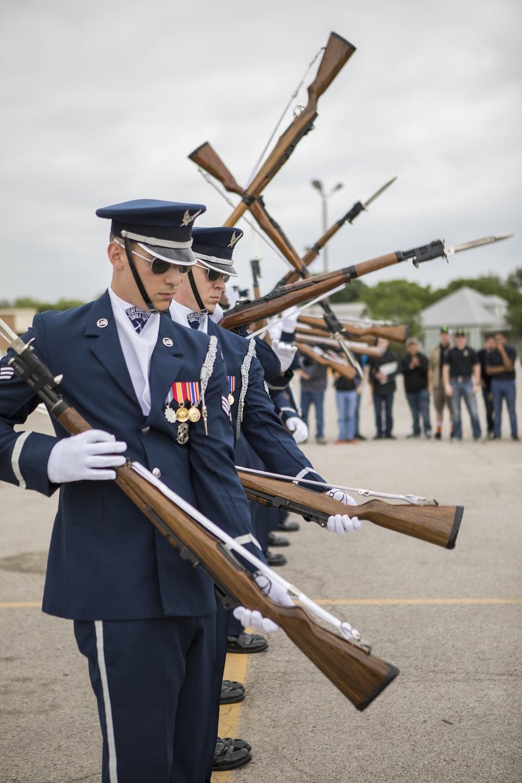 closeup photo of officer's holding guns