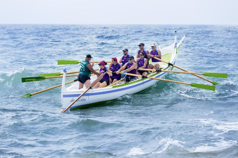 people paddling on sea