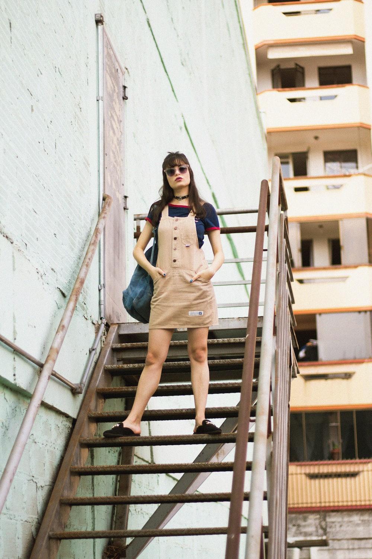 woman standing on stair beside door