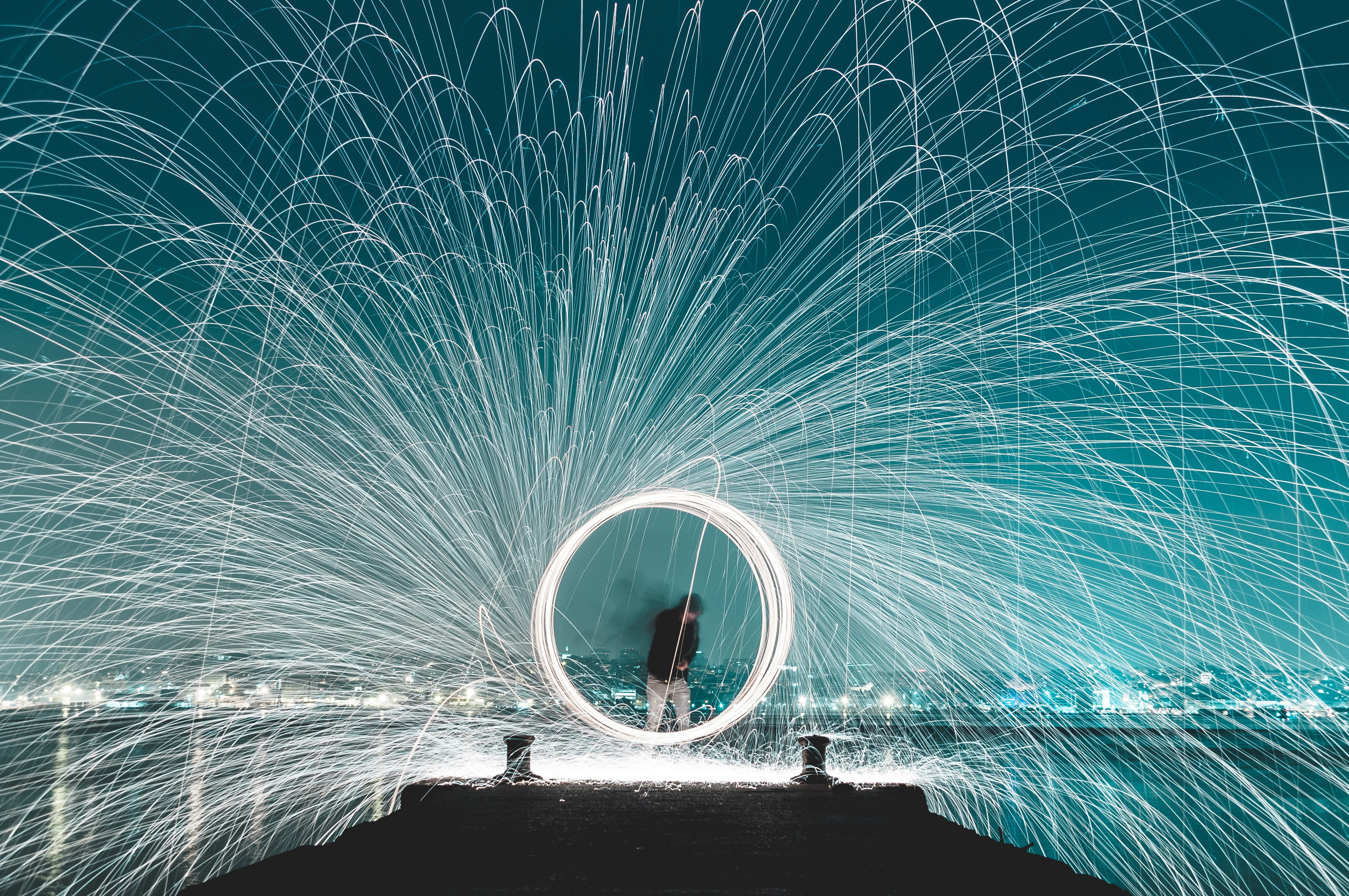 man standing on dock steel wool photography