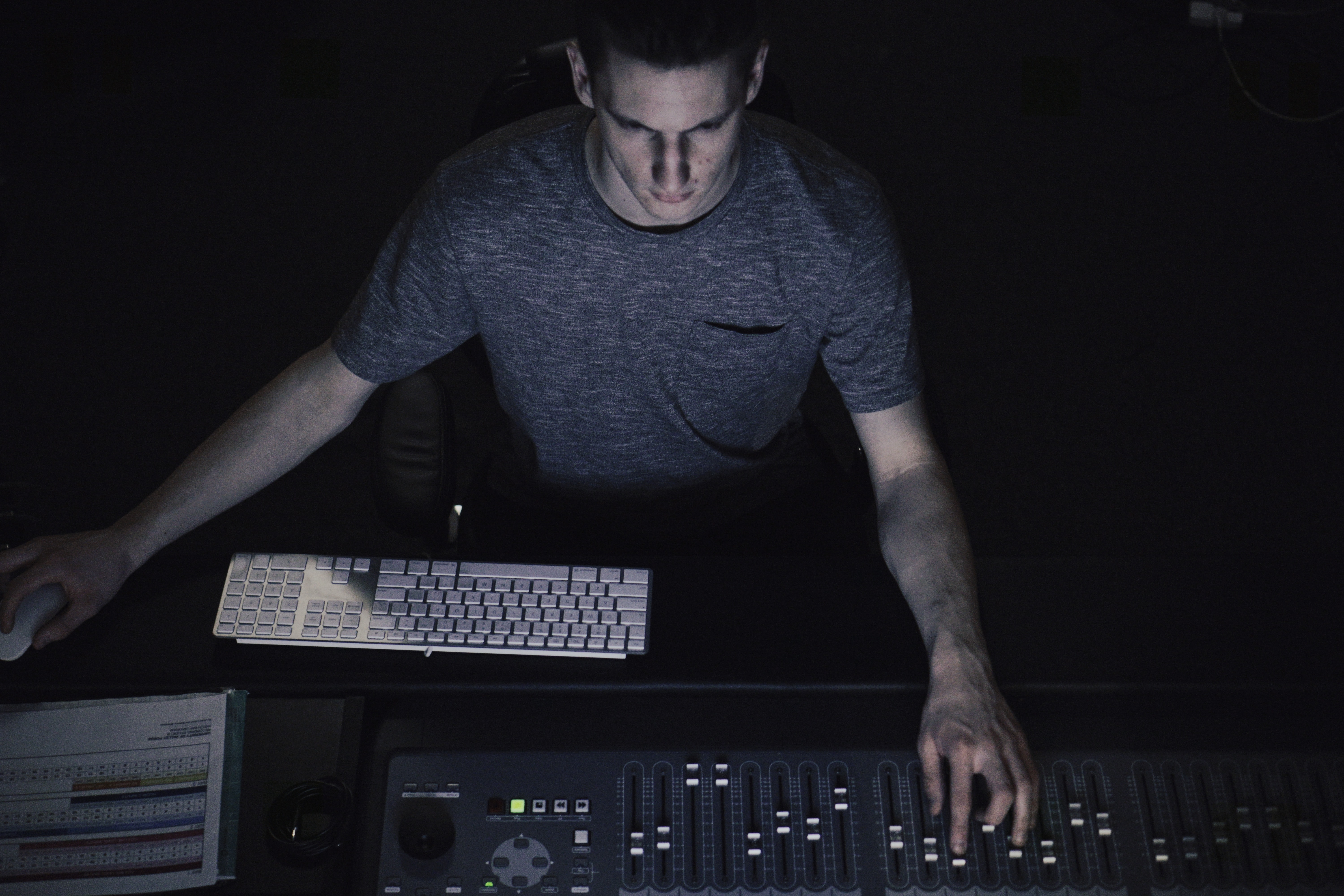 man in gray shirt using sound equalizer