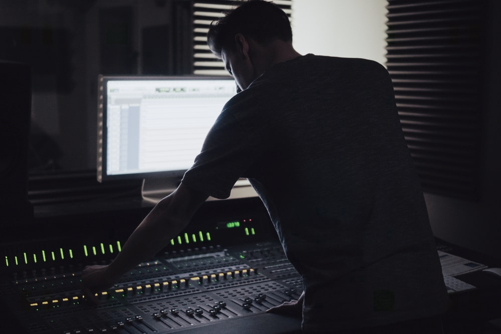 man operating audio mixer