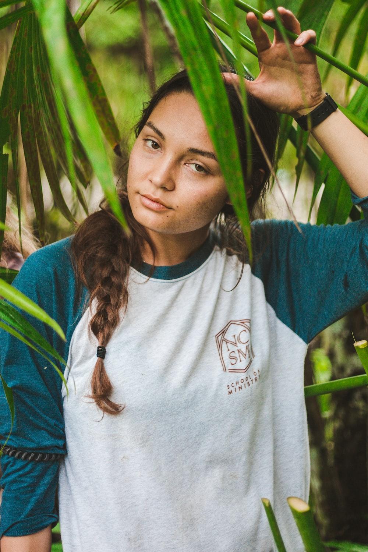woman standing under plants