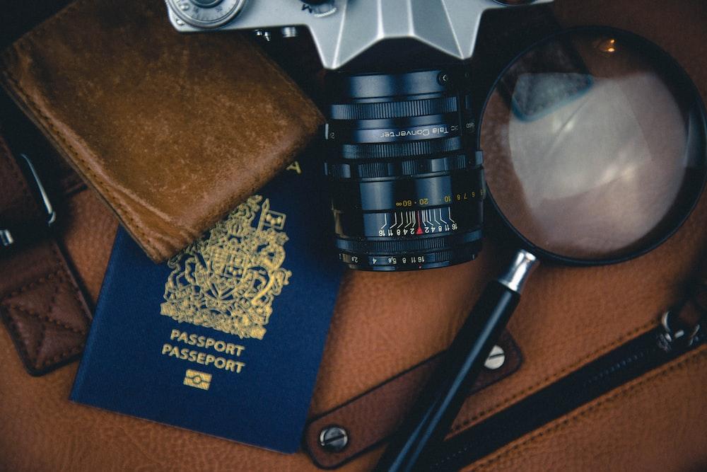 black magnifying glass and DSLR camera zoom lens