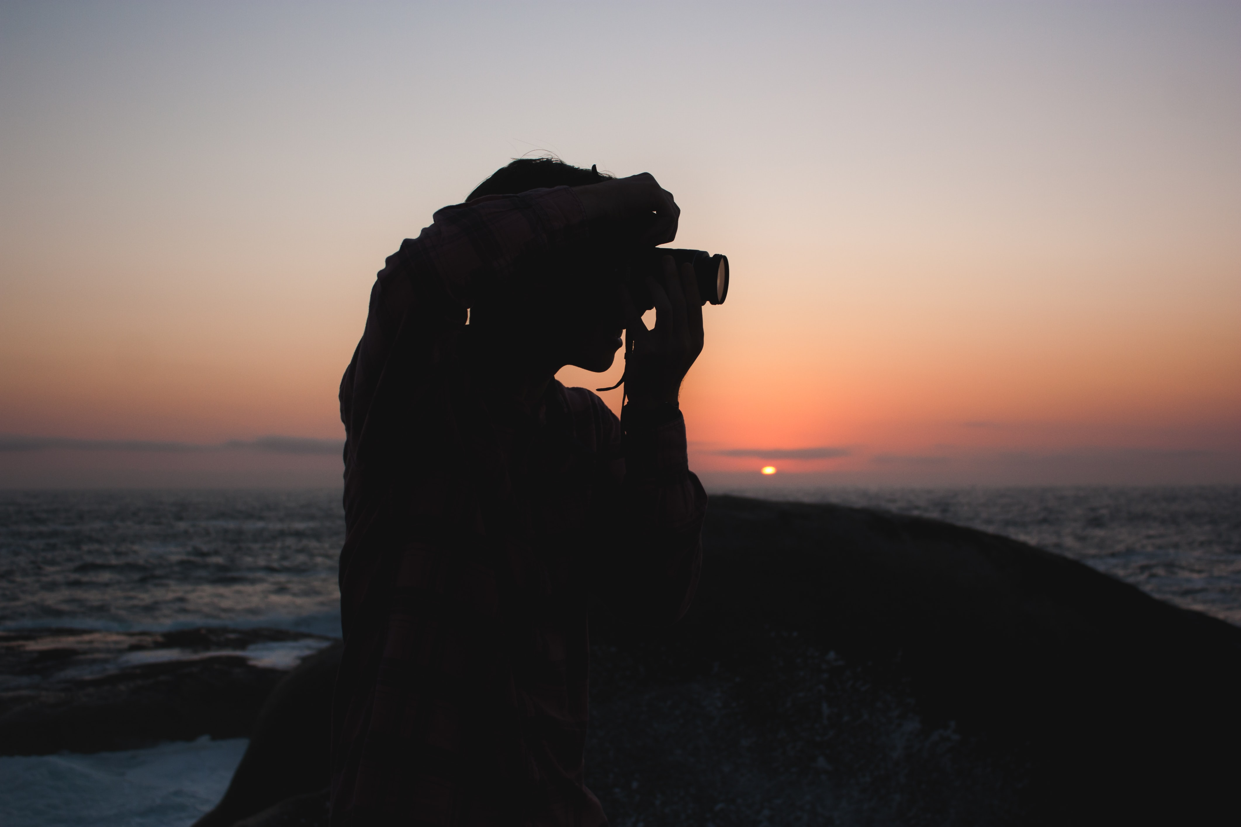 silhouette of person taking photograph