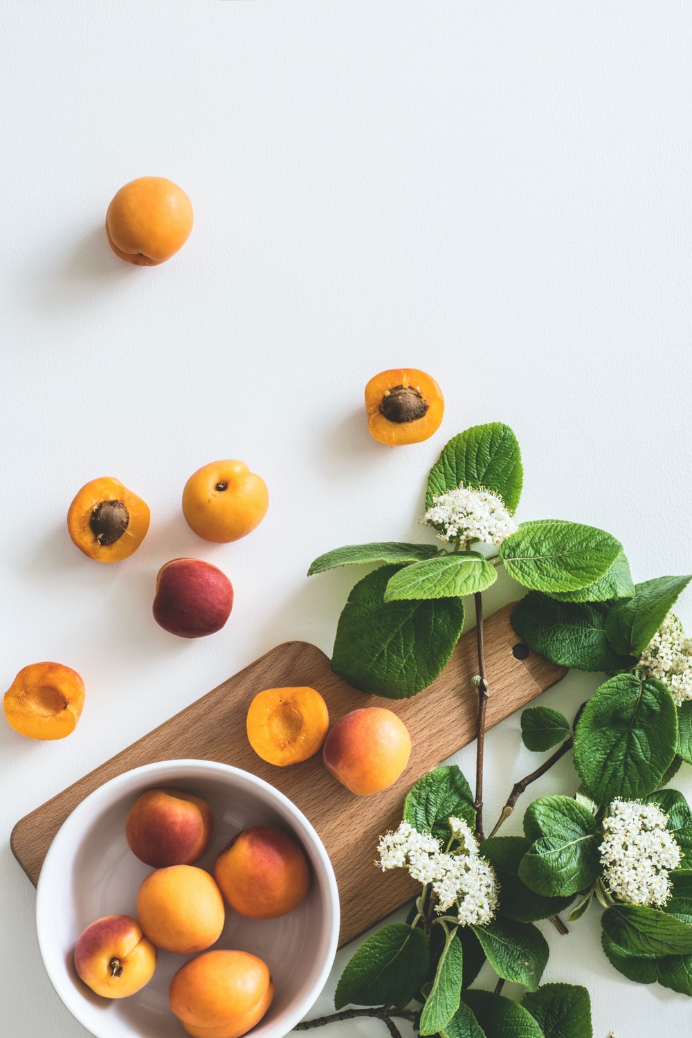 bunch of peach on white surface