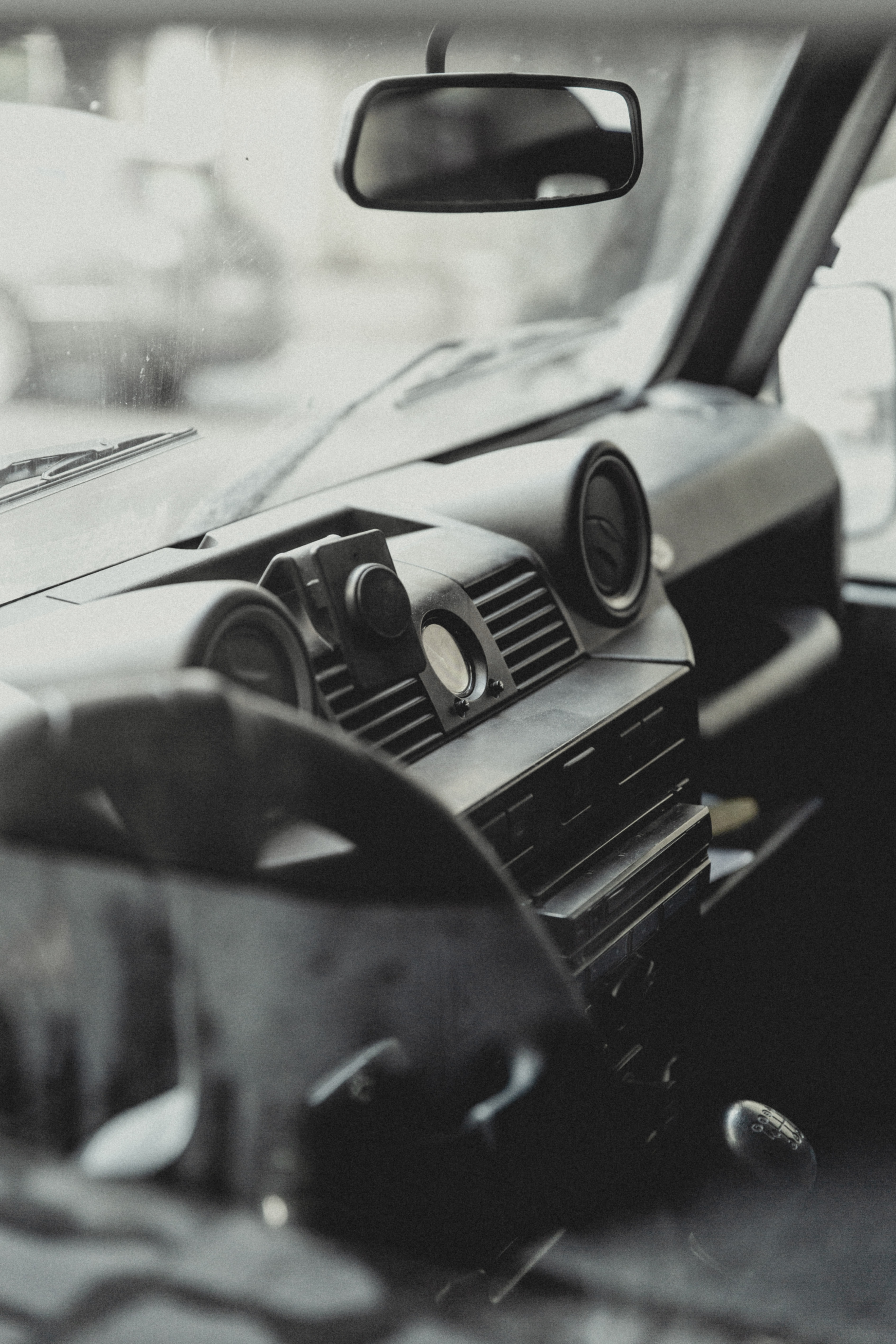 greyscale photo of vehicle dashboard console