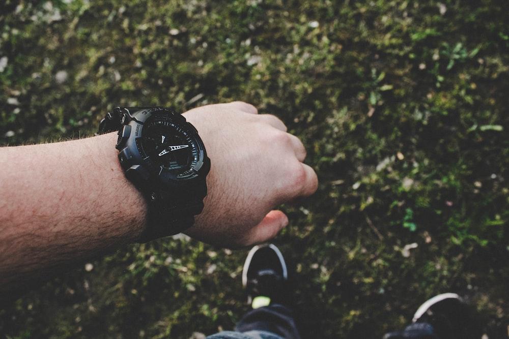person wearing black watch
