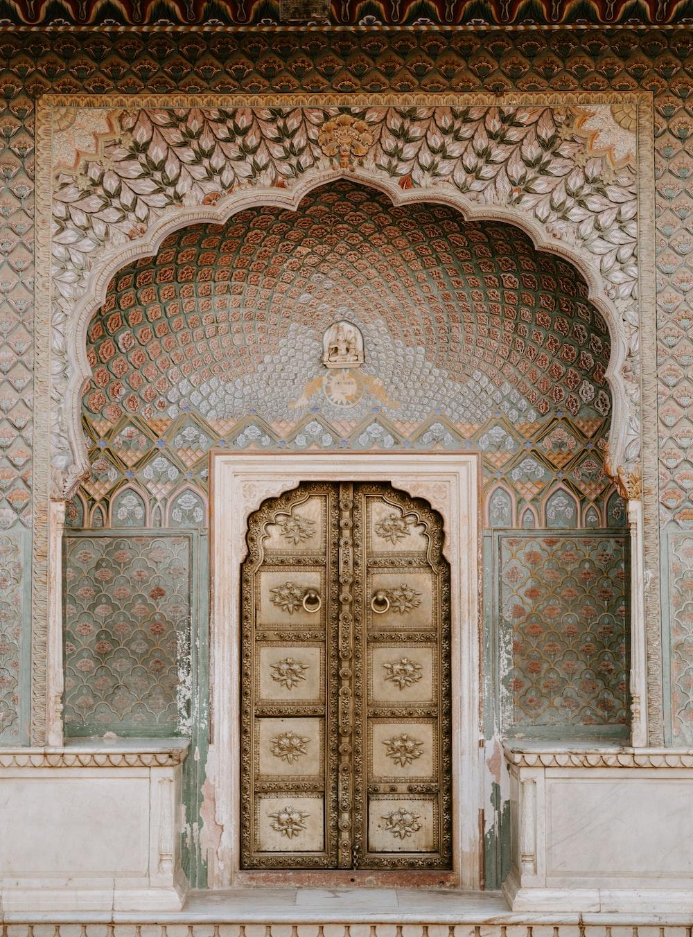 brown ornate wooden door