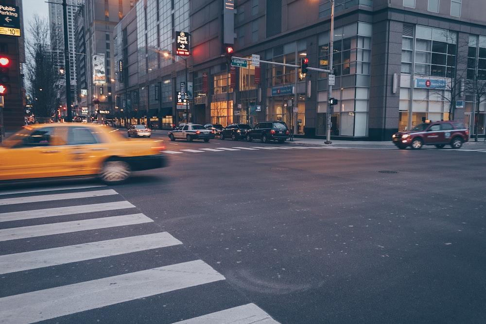 yellow car on white pedestrian lane