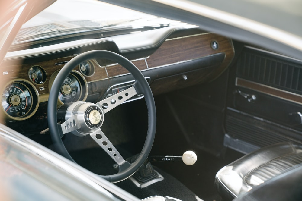 black and silver car wheel steering wheel
