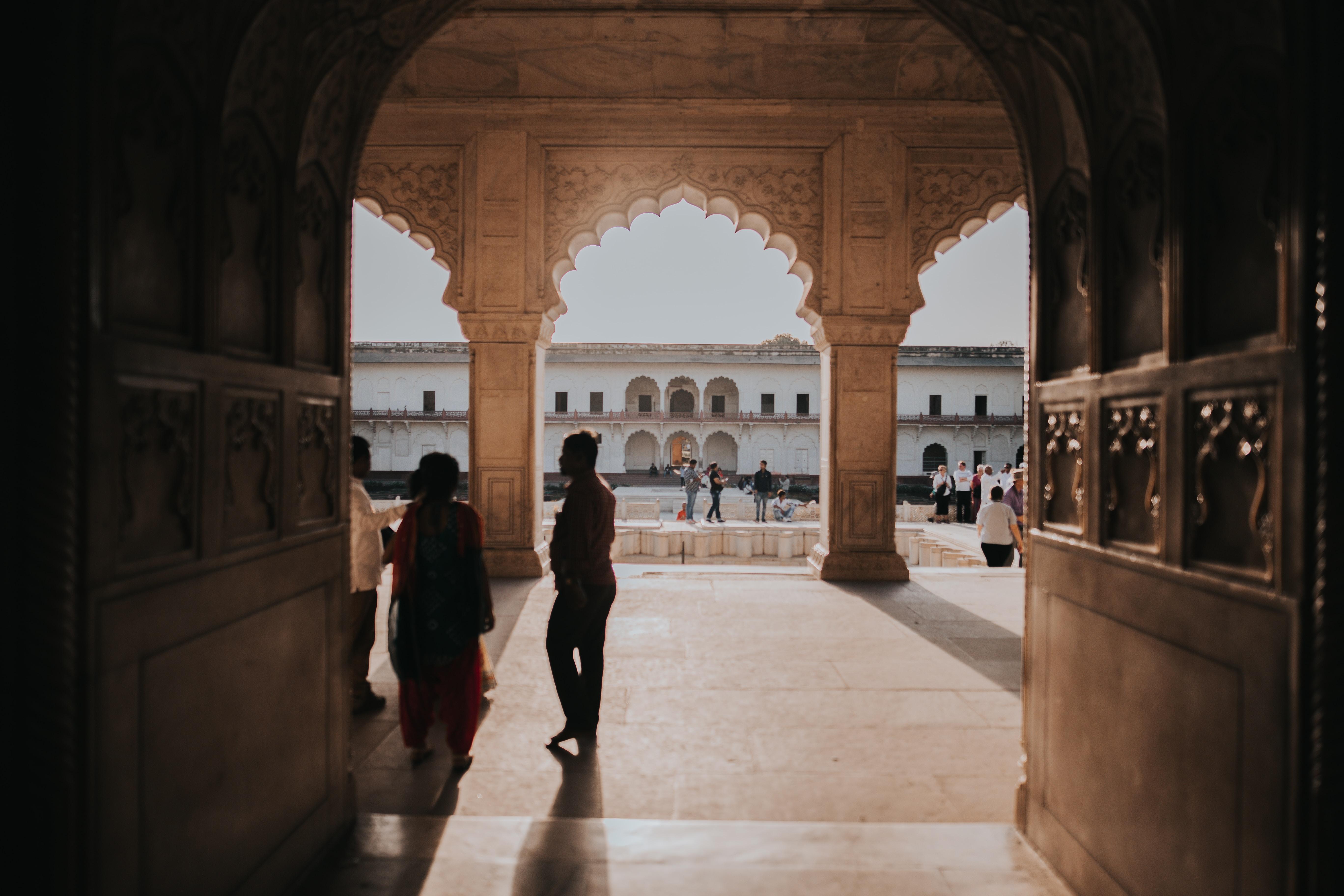 people walking near temple