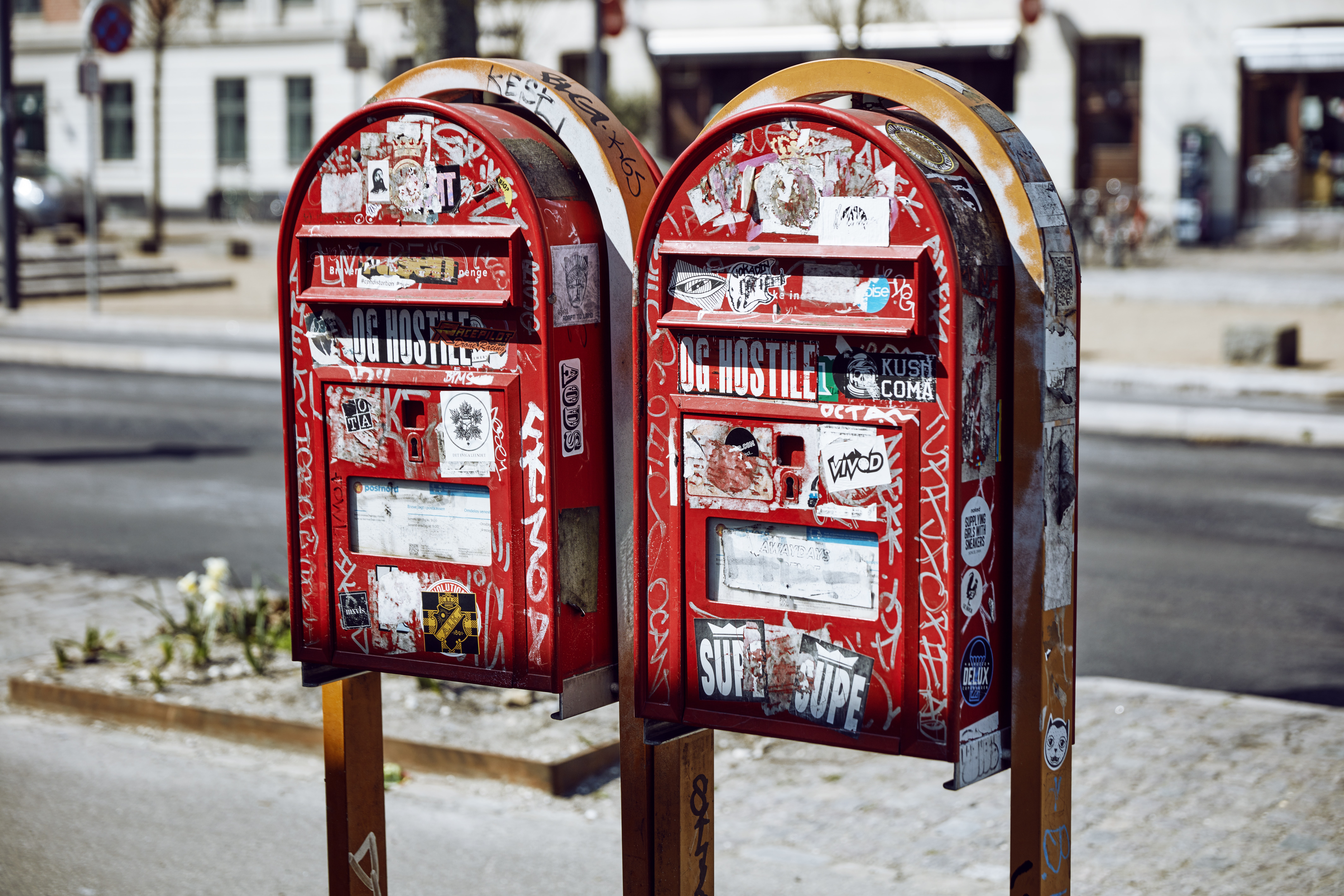 two mailboxes on street during daytime