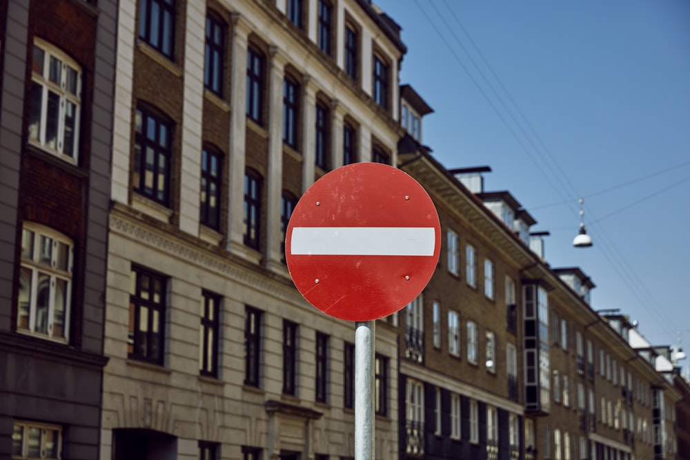white and red road signage