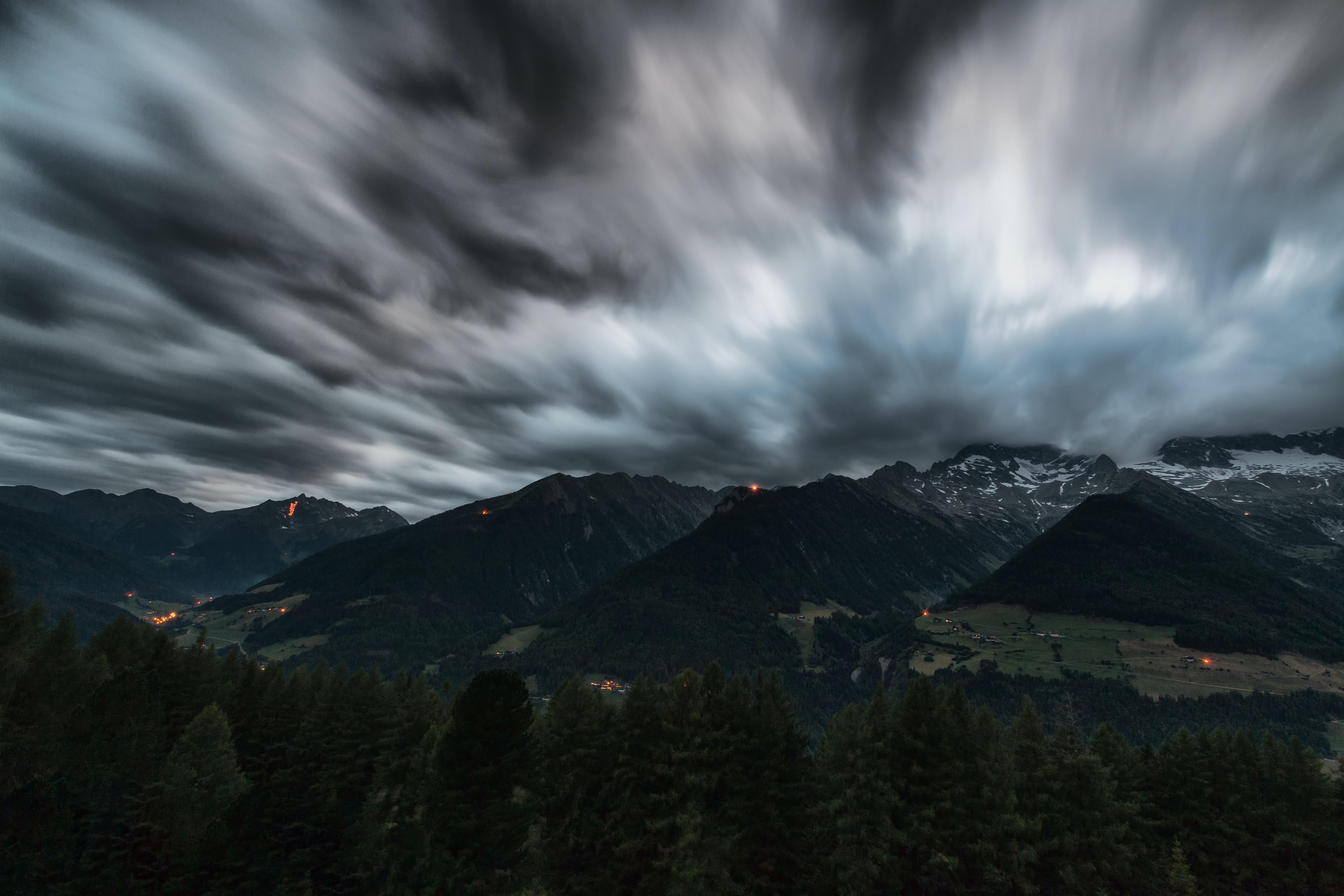 black mountain under nimbus clouds