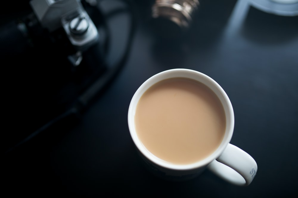 filled white ceramic mug