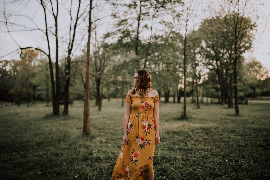girl standing alone in forest