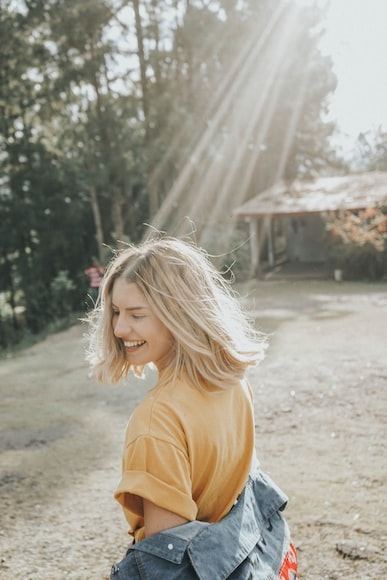 Girl smiling in sunshine shot