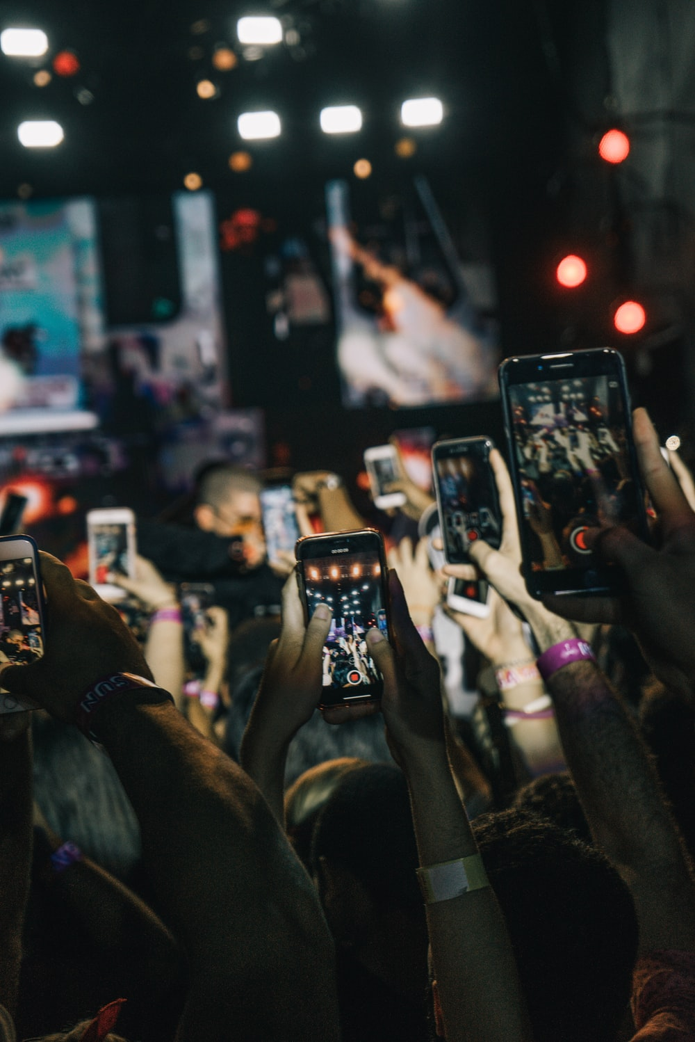 shallow focus photography of crowd taking video