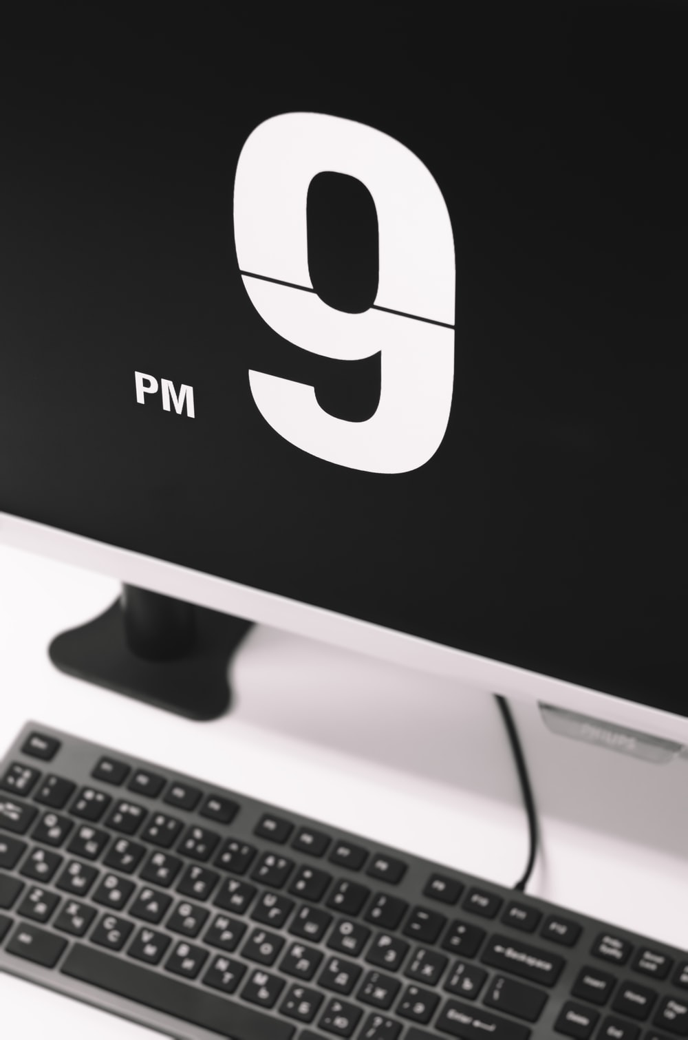 flat screen monitor displaying 9 PM