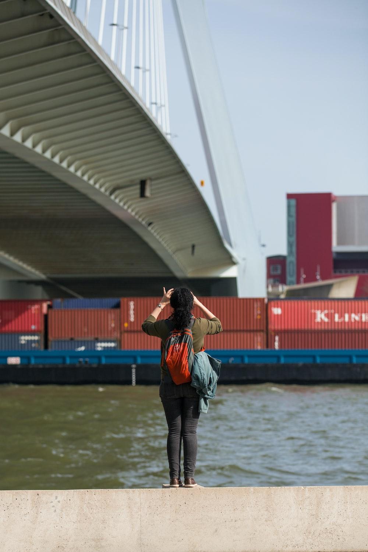 woman taking photo of bridge