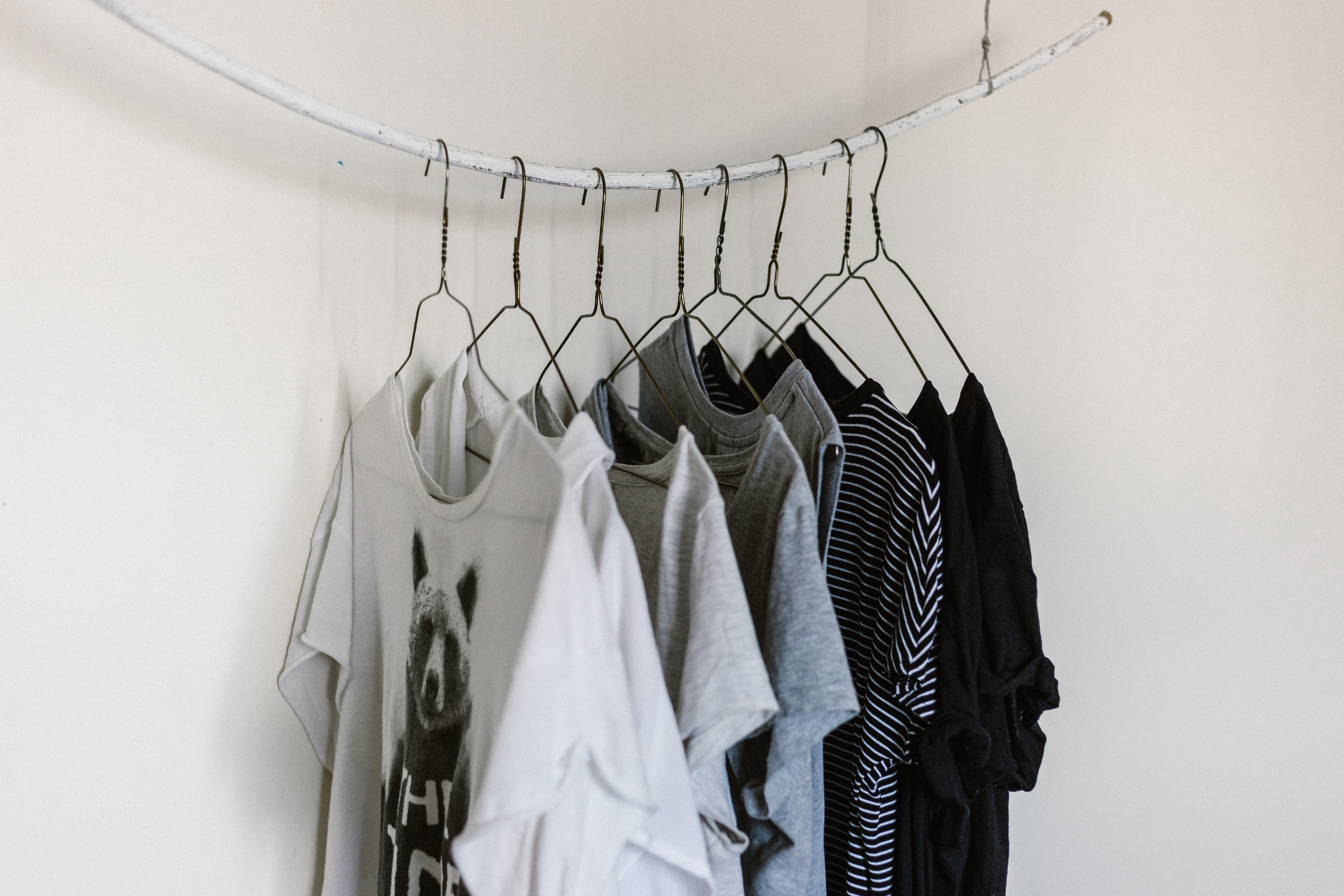 assorted-color clothes hanging on rod