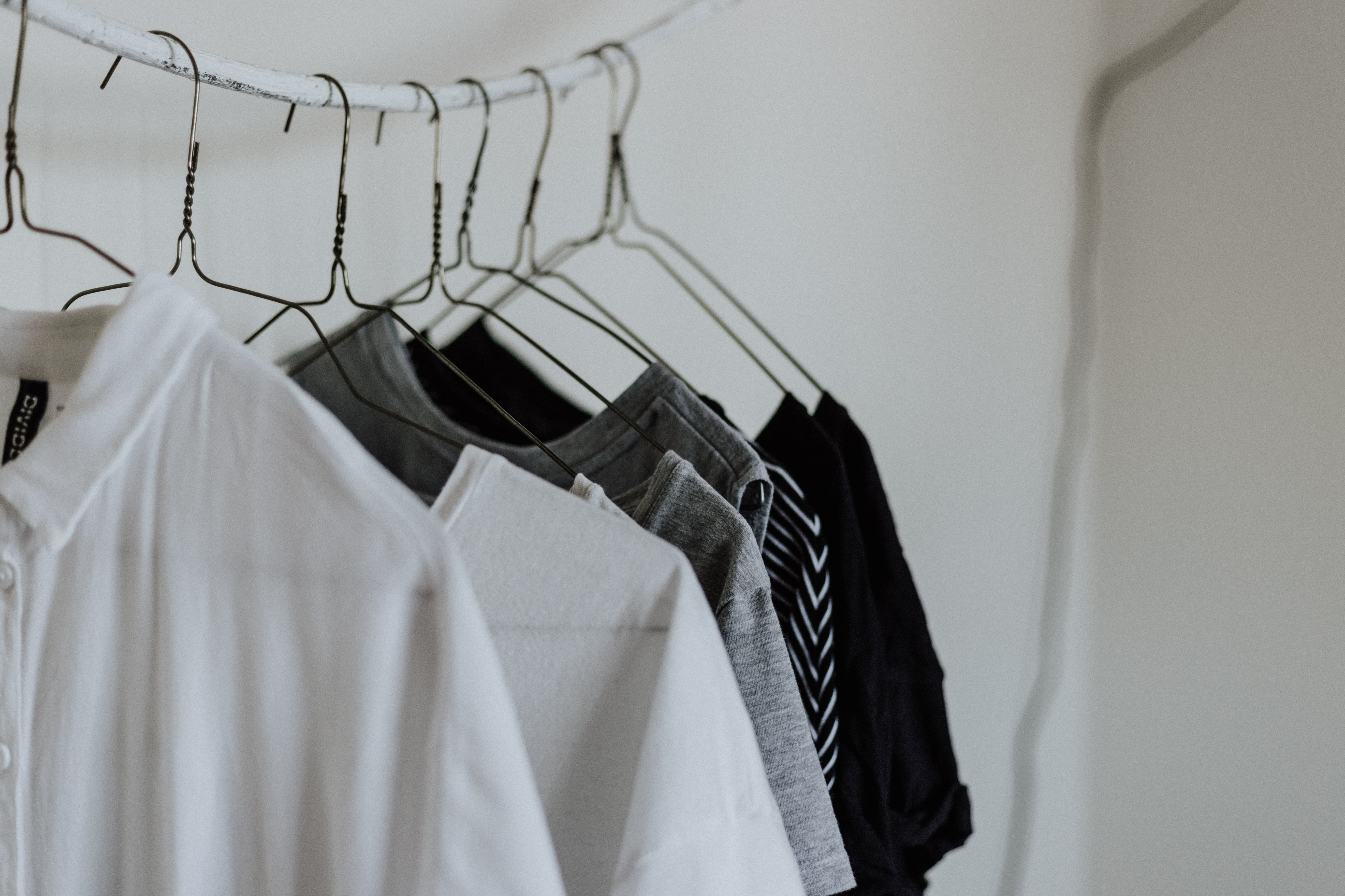 assorted-color shirt hanging beside wall