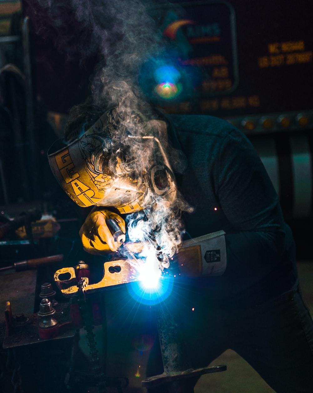 person welding metal tool