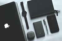 black MacBook, watch, smartphone and notebook