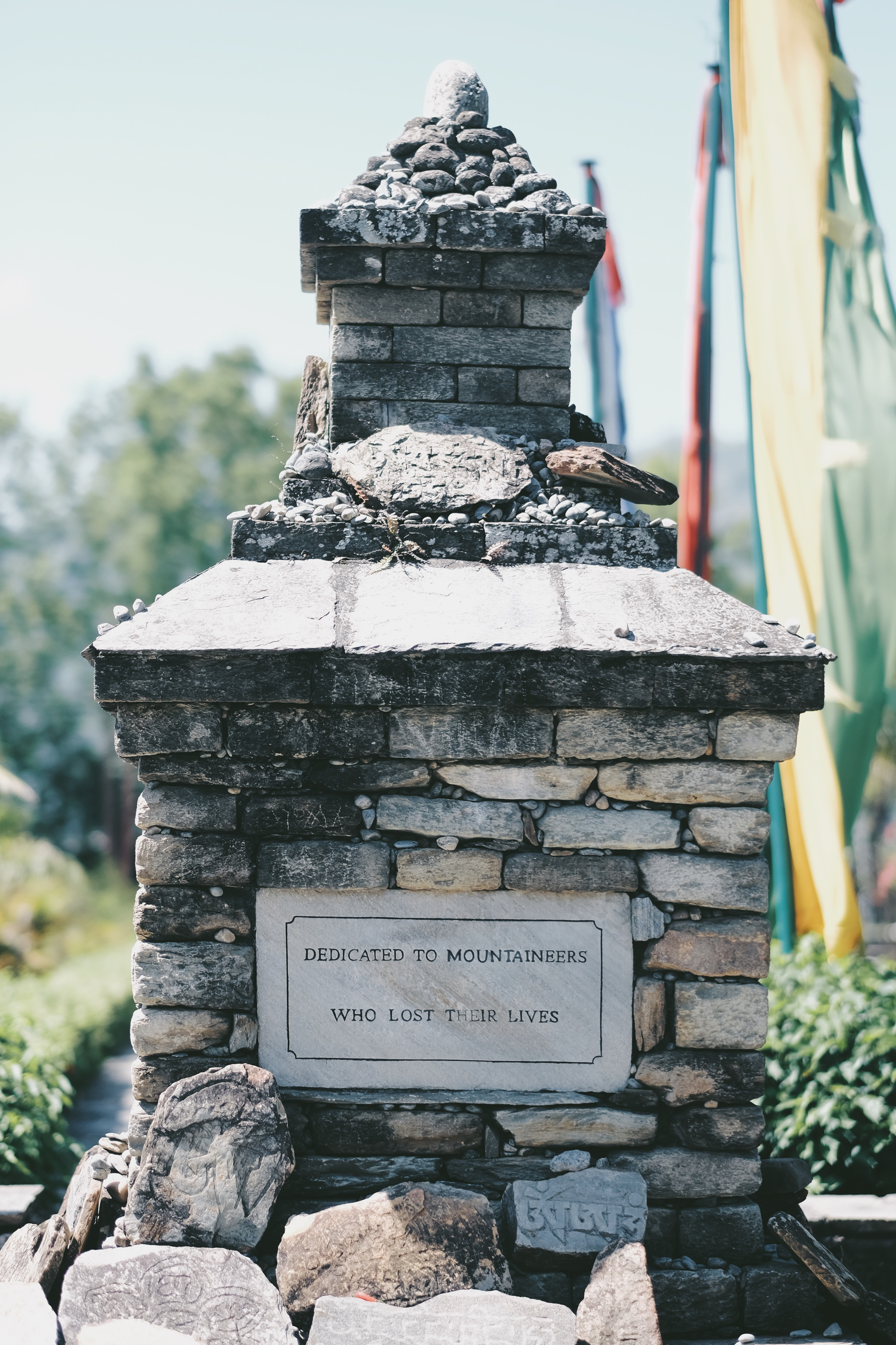 gray concrete dedicated to mountaineers who lost their lives tomb