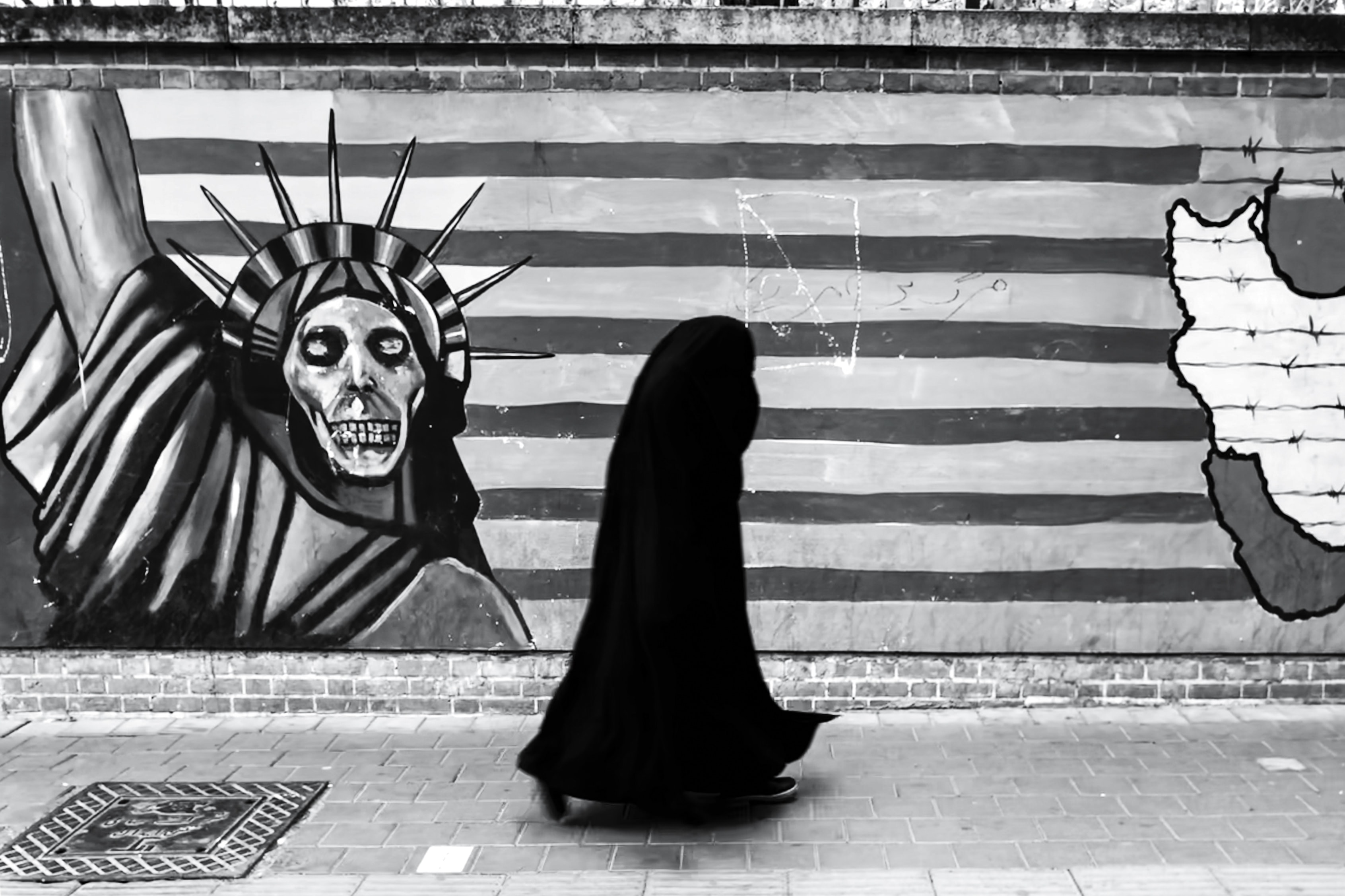 person standing near mural painting