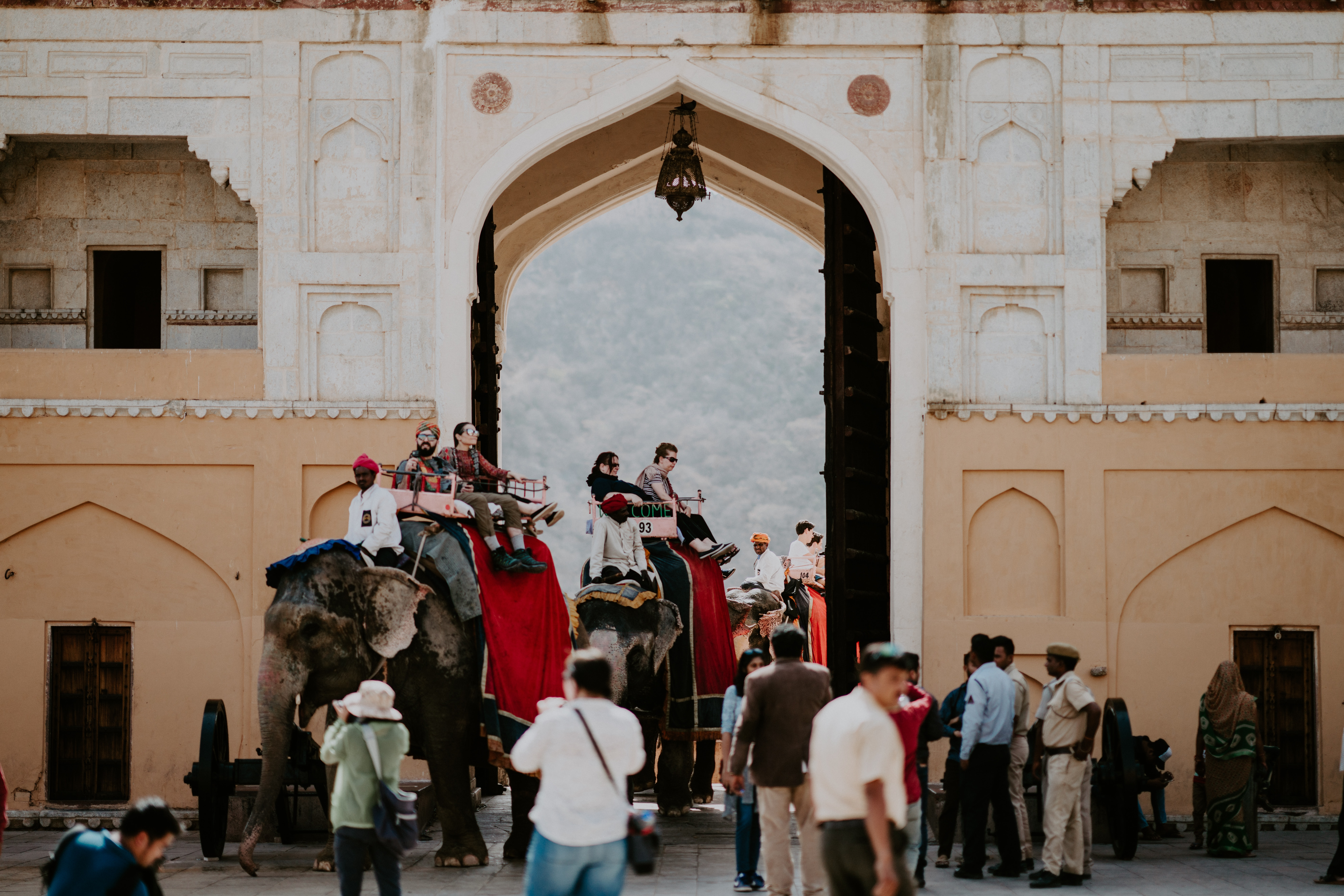 group of people near arch gate