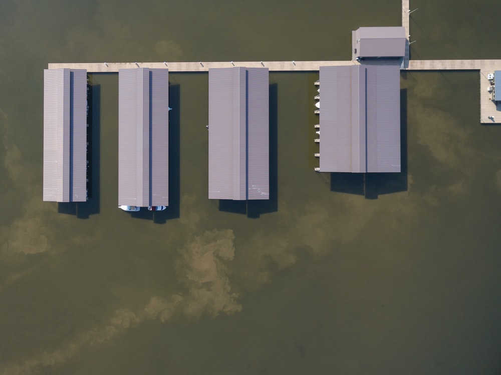 aerial photography of gray roof buildings on body of water