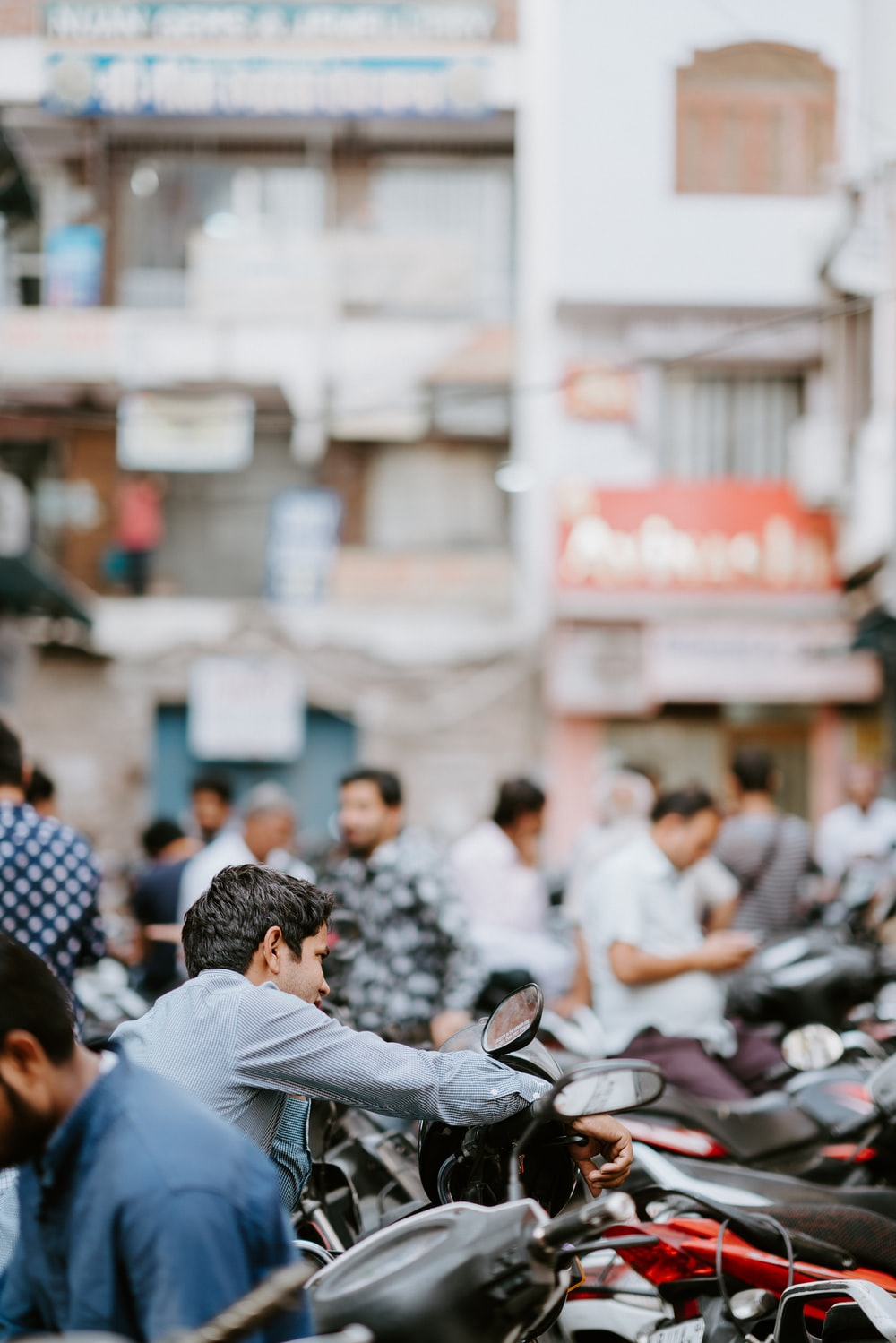 selective focus photo of man riding motorcycle