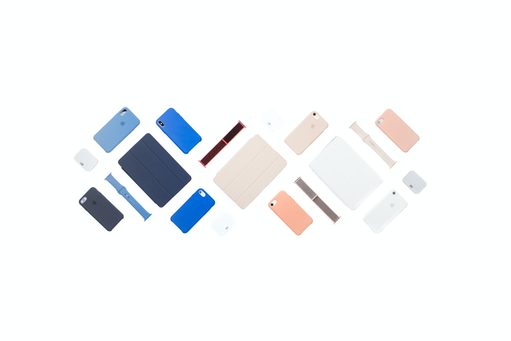 flat lay photography of smart device cases