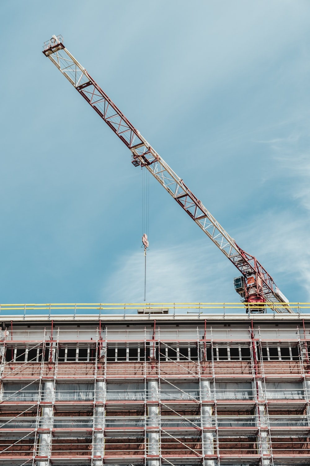 gray and brown crane on top of building