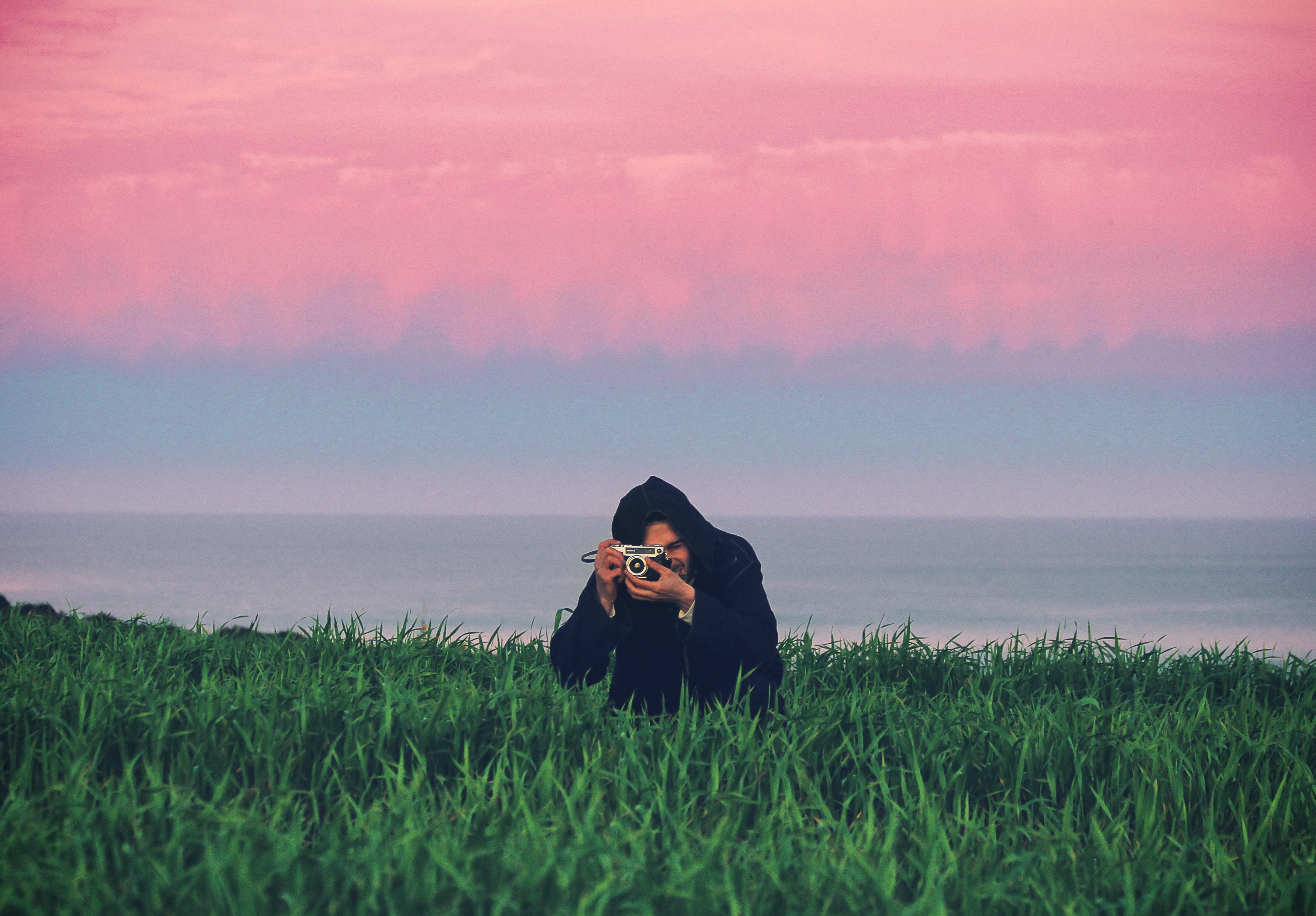 man standing on grass field