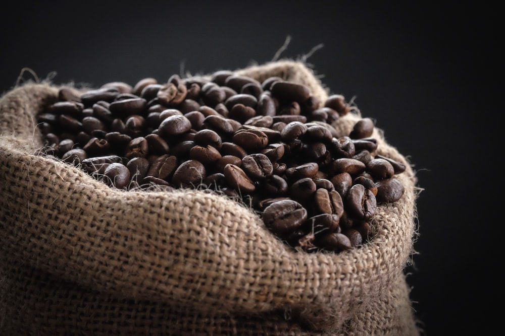 shallow focus photography of coffee beans in sack