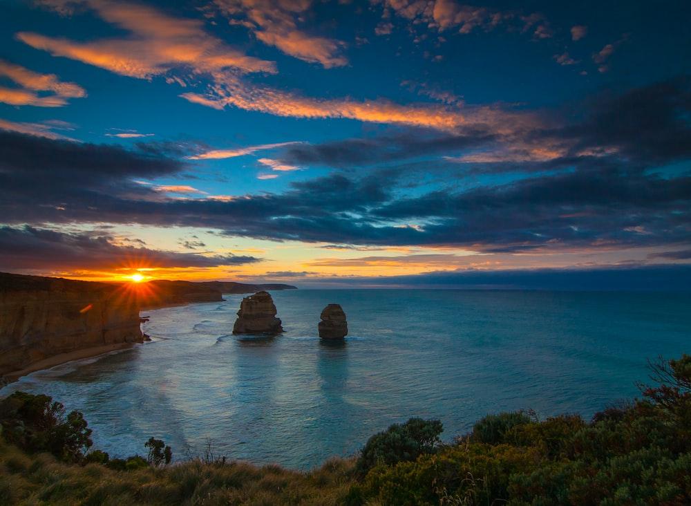 blue ocean water during sunset