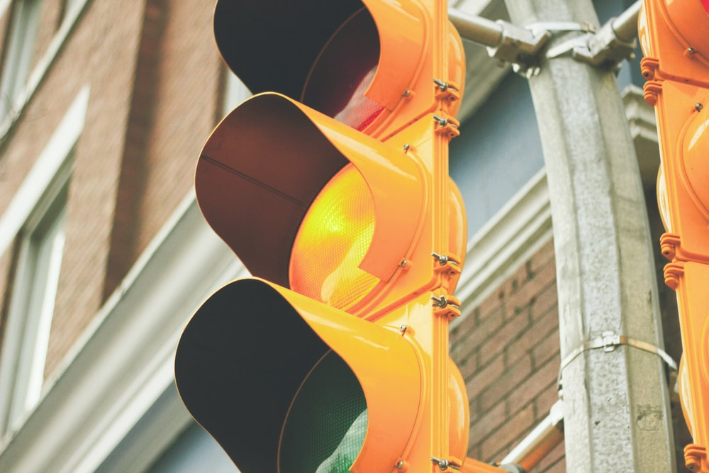 yellow painted traffic light